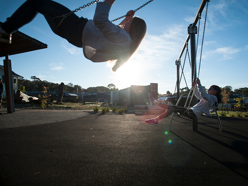 Springlake playgrounds with children on swings